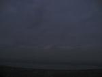 С трудом различимое в сумерках озеро Белое на горизонте.